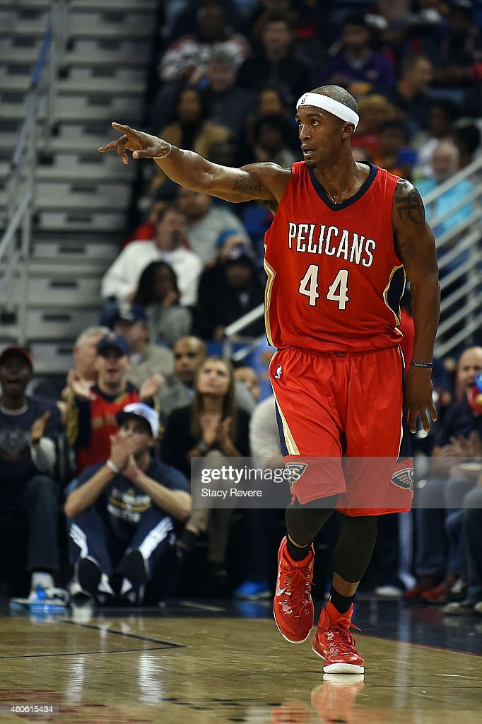 Dante Cunningham #44 of the New Orleans Pelicans reacts to a score during the first half of a game against the Utah Jazz at the Smoothie King Center on December 16, 2014 in New Orleans, Louisiana.
