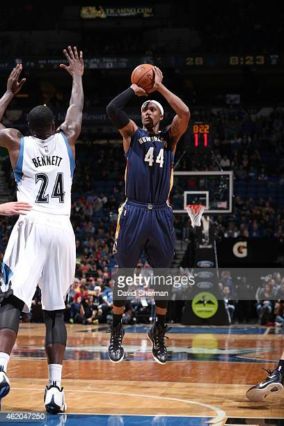 Dante Cunningham of the New Orleans Pelicans shoots against Anthony Bennett of the Minnesota Timberwolves on January 23 2015 at Target Center in...