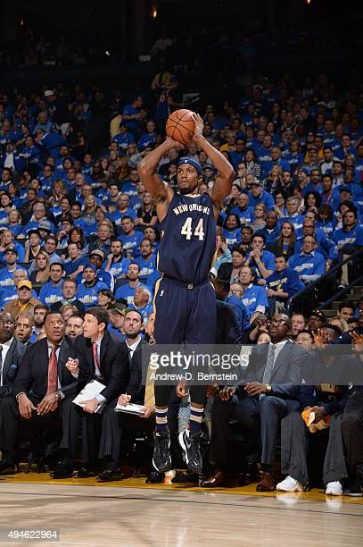 Dante Cunningham of the New Orleans Pelicans shoots the ball against the Golden State Warriors on October 27 2015 at ORACLE Arena in Oakland...