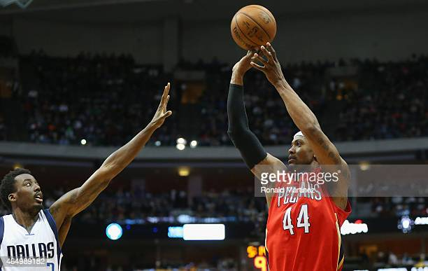 Dante Cunningham of the New Orleans Pelicans takes a shot against AlFarouq Aminu of the Dallas Mavericks at American Airlines Center on March 2 2015...