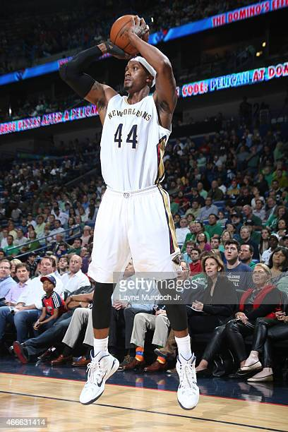 Dante Cunningham of the New Orleans Pelicans takes a shot against the Milwaukee Bucks on March 17 2015 at the Smoothie King Center in New Orleans...