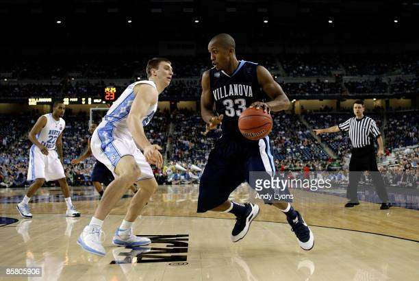 Dante Cunningham of the Villanova Wildcats drives in the second half against Tyler Hansbrough of the North Carolina Tar Heels during the National...