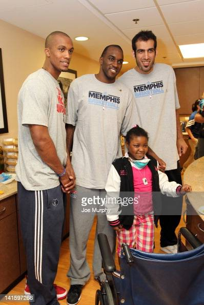 Dante Cunningham Quincy Pondexter and Hamed Haddadi of the Memphis Grizzlies pose for a photograph during a visit with children on March 15 2012 at...