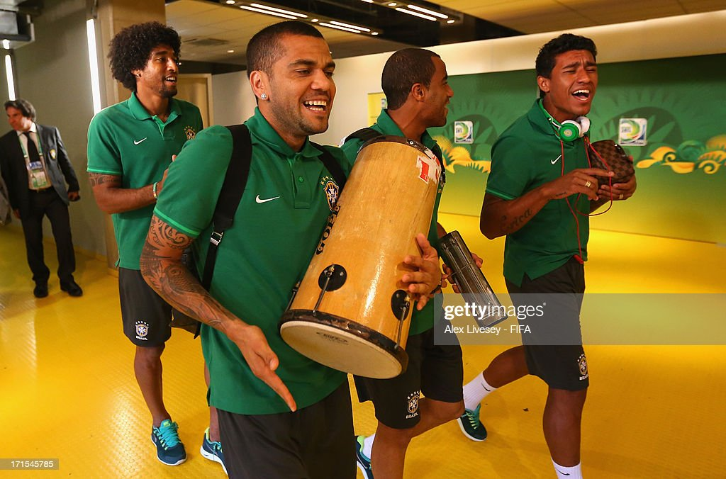 Dante, Daniel Alves, Lucas Moura and Paulinho of Brazil arrive at the stadium playing musical instrumenets prior to the FIFA Confederations Cup Brazil 2013 Semi Final match between Brazil and Uruguay at Governador Magalhaes Pinto Estadio Mineirao on June 26, 2013 in Belo Horizonte, Brazil.
