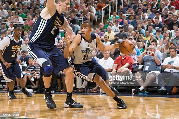 Dante Exum of the Utah Jazz drives against Greg Somogyi during an open scrimmage at Energy Solutions Arena on July 8 2014 in Salt Lake City Utah NOTE...