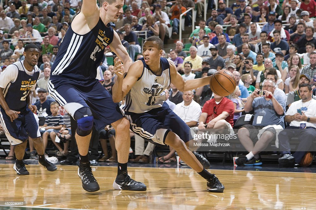 Dante Exum #11 of the Utah Jazz drives against Greg Somogyi #83 during an open scrimmage at Energy Solutions Arena on July 8, 2014 in Salt Lake City, Utah.