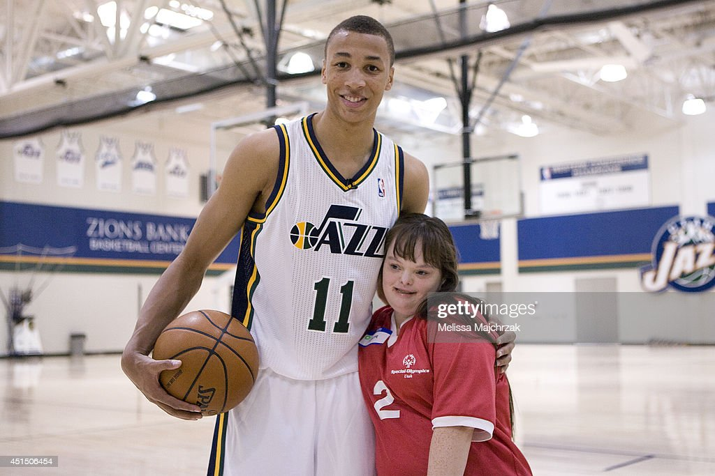 Dante Exum #11 of the Utah Jazz poses for a photo with a young fan at a special Olympics event at the Zions Basketball Center on June 28, 2014 in Salt Lake City, Utah.