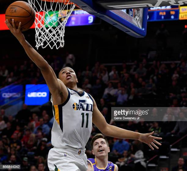 Dante Exum of the Utah Jazz scores in front of Dane Pineau of the Sydney Kings in the first half of their preseason game at Vivint Smart Home Arena...
