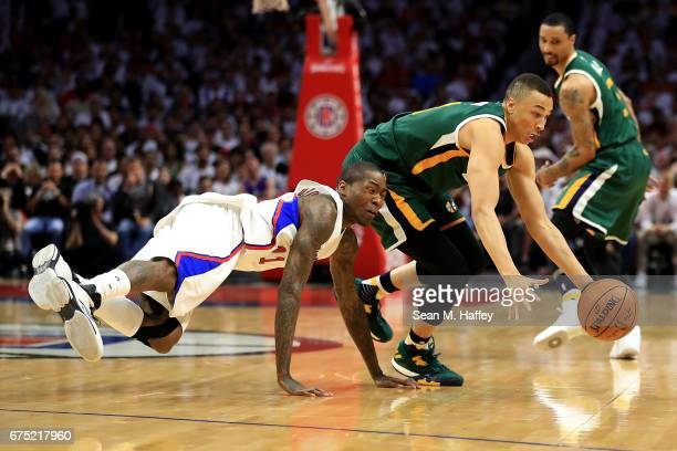 Dante Exum of the Utah Jazz steals the ball from Jamal Crawford of the Los Angeles Clippers during the first half of Game Seven of the Western...