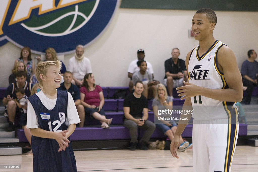 Dante Exum #11 of the Utah Jazz talks with a young fan at a special Olympics event at the Zions Basketball Center on June 28, 2014 in Salt Lake City, Utah.