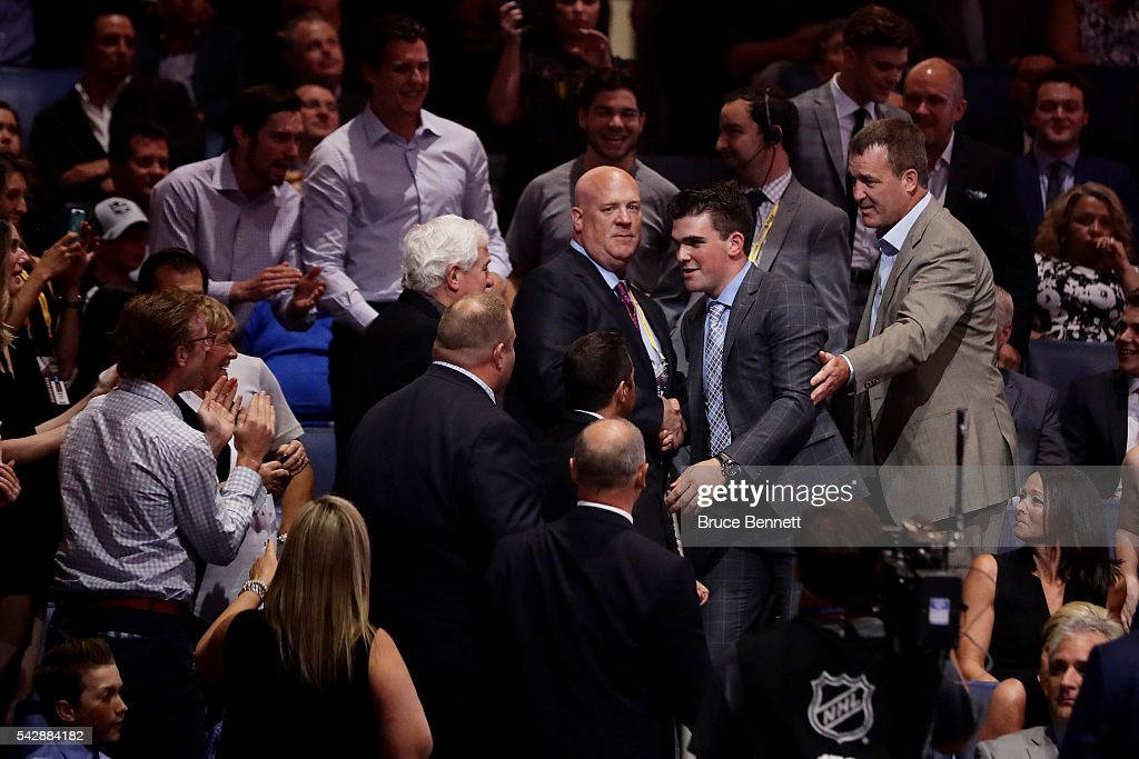 Dante Fabbro celebrates after being selected 17th by the Nashville Predators during round one of the 2016 NHL Draft on June 24, 2016 in Buffalo, New York.