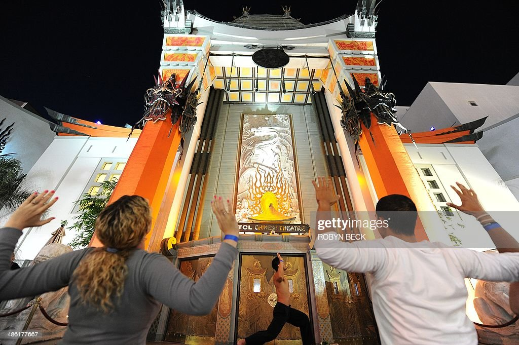 Dante Fernandez leads a free outdoor yoga class to celebrate Earth Day in the forecourt of the iconic TCL Chinese Theatre formerly the Grauman's...