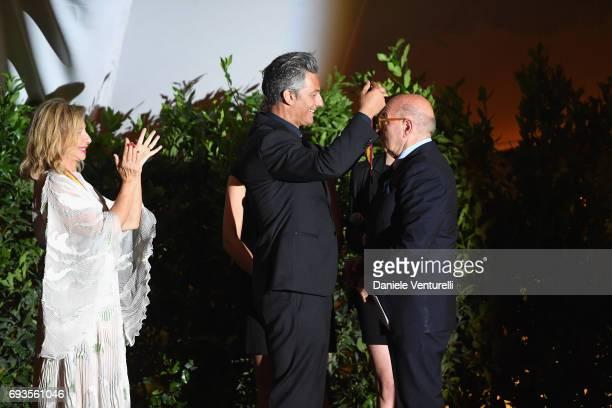 Dante Ferretti is awarded by Rosario Fiorello on the stage of McKim Medal Gala at Villa Aurelia on June 7 2017 in Rome Italy
