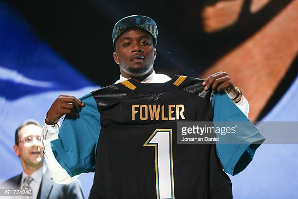 Dante Fowler Jr of the Florida Gators holds up a jersey after being chosen overall by the Jacksonville Jaguars during the first round of the 2015 NFL...