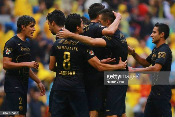 Dante Lopez of Pumas celebrate with his teammates after scoring the winning goal of his team during a match between America and Pumas UNAM as part of...