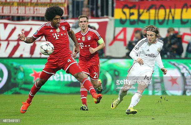 Dante of Bayern Muenchen and Luka Modric of Real Madrid in action during the UEFA Champions League semifinal second leg match between FC Bayern...