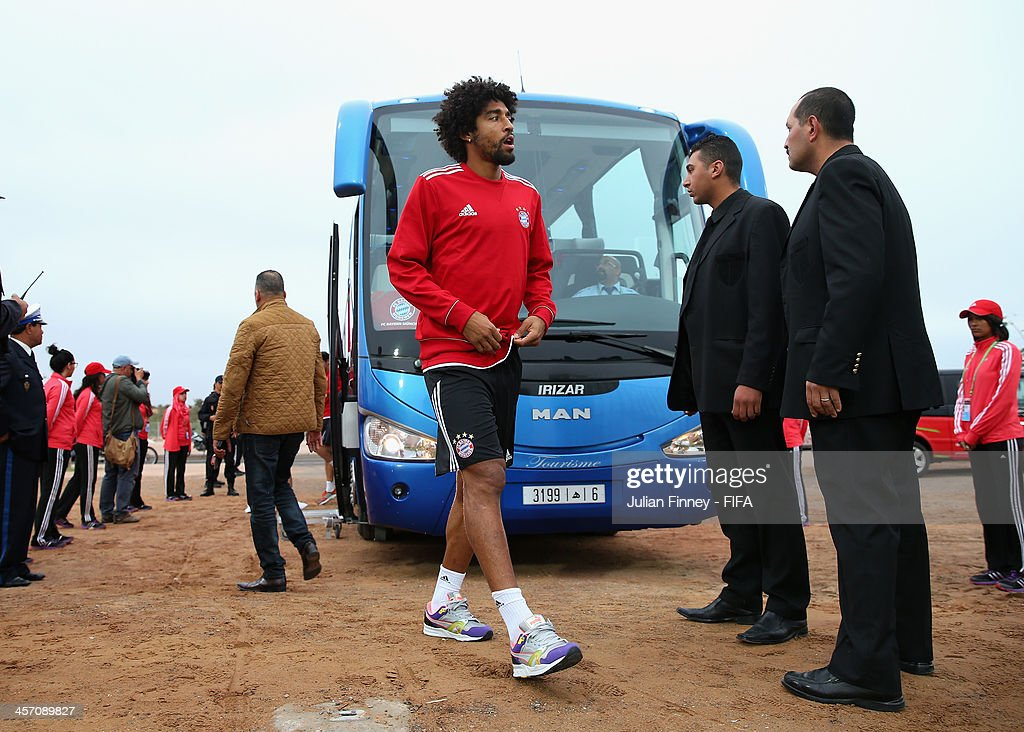 Dante of Bayern Muenchen arrives during a training session outside the Agadir Stadium on December 16, 2013 in Agadir, Morocco.