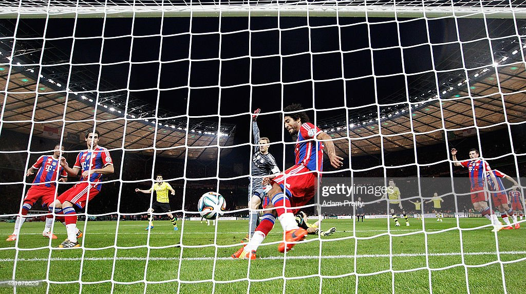 Dante of Bayern Muenchen attempts to clear <a gi-track='captionPersonalityLinkClicked' href=/galleries/search?phrase=Mats+Hummels&family=editorial&specificpeople=595395 ng-click='$event.stopPropagation()'>Mats Hummels</a> of Borussia Dortmunds shot off the line during the DFB Cup Final match in between Borussia Dortmund and FC Bayern Muenchen at Olympiastadion on May 17, 2014 in Berlin, Germany.