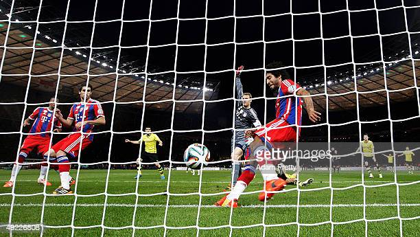 Dante of Bayern Muenchen attempts to clear Mats Hummels of Borussia Dortmunds shot off the line during the DFB Cup Final match in between Borussia...