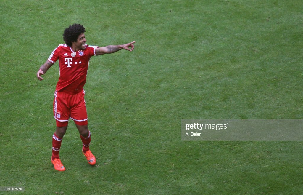 Dante of Bayern Muenchen celebrates his goal during the Bundesliga match between FC Bayern Muenchen and SC Freiburg at Allianz Arena on February 15, 2014 in Munich, Germany.