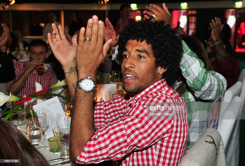 Dante of Bayern Muenchen celebrates winning the German championship during the Official Champion dinner at Postpalast on May 12, 2013 in Munich, Germany.