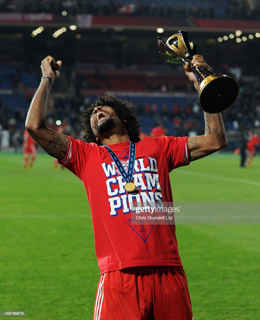 Dante of Bayern Muenchen celebrates with the trophy following the FIFA Club World Cup Final match between Bayern Muenchen and Raja Casablanca at Marrakech Stadium on December 21, 2013 in Marrakech, Morocco.