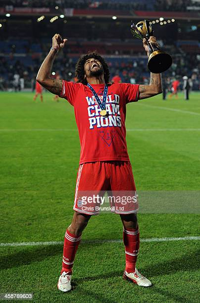 Dante of Bayern Muenchen celebrates with the trophy following the FIFA Club World Cup Final match between Bayern Muenchen and Raja Casablanca at...