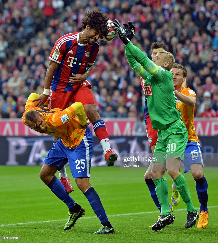Dante of Bayern Muenchen heads the ball against John Anthony Brooks and <a gi-track='captionPersonalityLinkClicked' href=/galleries/search?phrase=Sascha+Burchert&family=editorial&specificpeople=2268765 ng-click='$event.stopPropagation()'>Sascha Burchert</a> during the game FC Bayern Muenchen against Hertha BSC on april 25, 2015 in Muenchen, Germany.