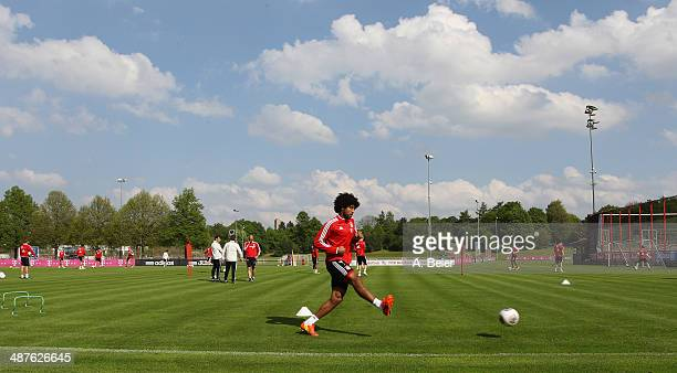 Dante of Bayern Muenchen kicks the ball during a training session at the FC Bayern Muenchen training ground on May 1 2014 in Munich Germany