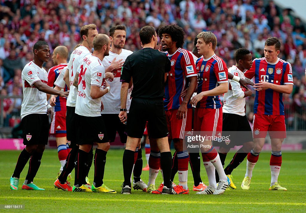 Dante of Bayern Muenchen protests to referee Bastian Dankert during the Bundesliga match between Bayern Muenchen and VfB Stuttgart at Allianz Arena on May 10, 2014 in Munich, Germany.