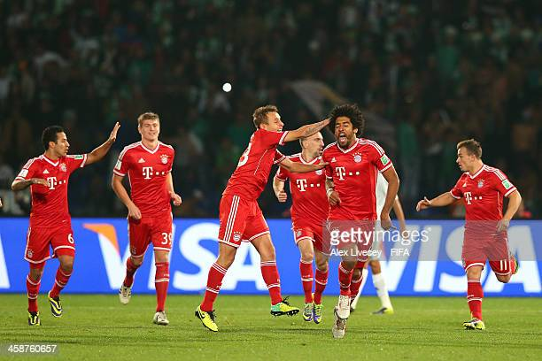 Dante of FC Bayern Munchen celebrates after scoring the opening goal during the FIFA Club World Cup Final between FC Bayern Munchen and Raja...