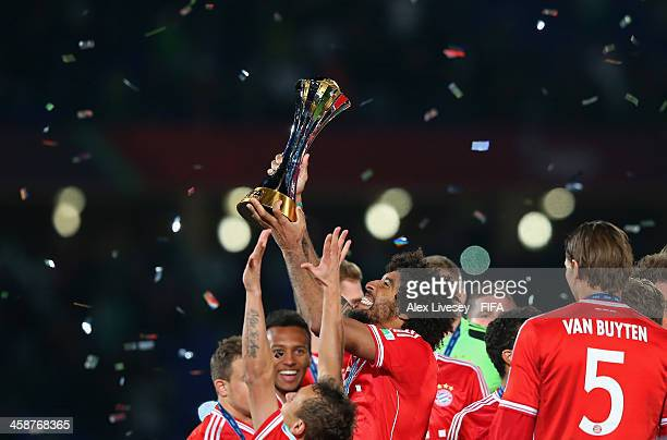 Dante of FC Bayern Munchen lifts the FIFA Club World Cup after victory in the FIFA Club World Cup Final between FC Bayern Munchen and Raja Casablanca...