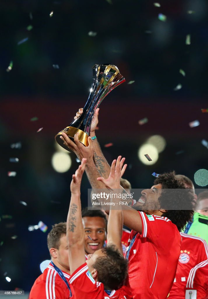 Dante of FC Bayern Munchen lifts the FIFA Club World Cup after victory in the FIFA Club World Cup Final between FC Bayern Munchen and Raja Casablanca at Marrakech Stadium on December 21, 2013 in Marrakech, Morocco.