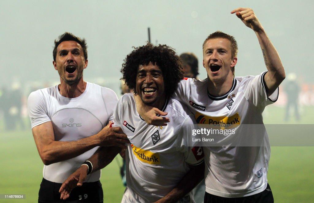 Dante of Moenchengladbach celebrates with team mates Martin Stranzl and Marco Reus after the Bundesliga play off second leg match between VfL Bochum...