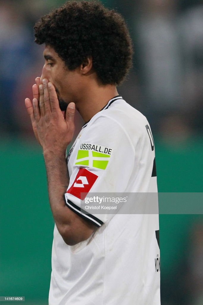 Dante of Moenchengladbach looks dejected after missing a penalty durign the penalty shoot-out during the DFB Cup semi final match between Borussia Moenchengladbach and FC Bayern Muenchen at Borussia Park Stadium on March 21, 2012 in Moenchengladbach, Germany. Bayern won 4-2 against Moenchengladbach after pelanty-shoot out.