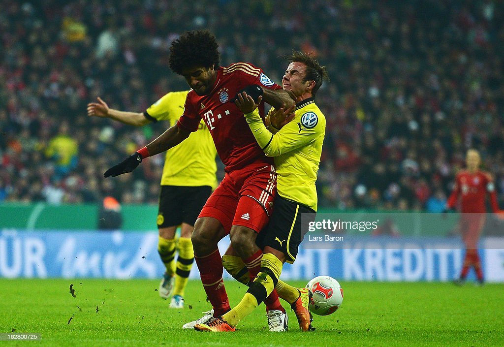 Dante of Muenchen challenges <a gi-track='captionPersonalityLinkClicked' href=/galleries/search?phrase=Mario+Goetze&family=editorial&specificpeople=4251202 ng-click='$event.stopPropagation()'>Mario Goetze</a> of Dortmund during the DFB cup quarter final match between Bayern Muenchen and Borussia Dortmund at Allianz Arena on February 27, 2013 in Munich, Germany.