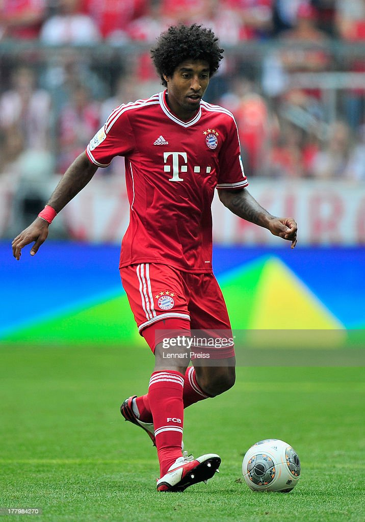 Dante of Muenchen in action during the Bundesliga match between FC Bayern Muenchen and 1. FC Nuernberg at Allianz Arena on August 24, 2013 in Munich, Germany.