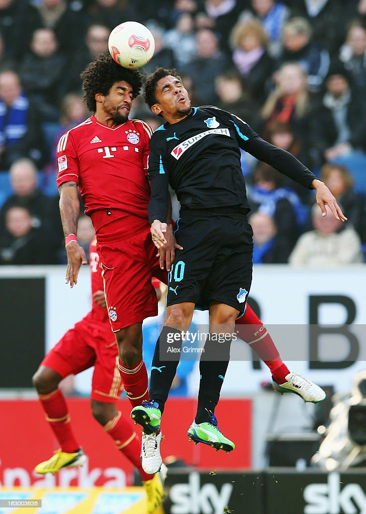 Dante (L) of Muenchen jumps for a header with <a gi-track='captionPersonalityLinkClicked' href=/galleries/search?phrase=Igor+de+Camargo&family=editorial&specificpeople=2514599 ng-click='$event.stopPropagation()'>Igor de Camargo</a> of Hoffenheim during the Bundesliga match between TSG 1899 Hoffenheim and FC Bayern Muenchen at Rhein-Neckar-Arena on March 3, 2013 in Sinsheim, Germany.