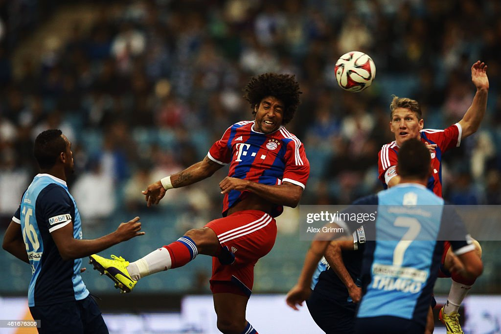 Dante of Muenchen scores his team's first goal during the friendly match between Al Hilal and Bayern Muenchen on January 17, 2015 in Riyadh, Saudi Arabia.