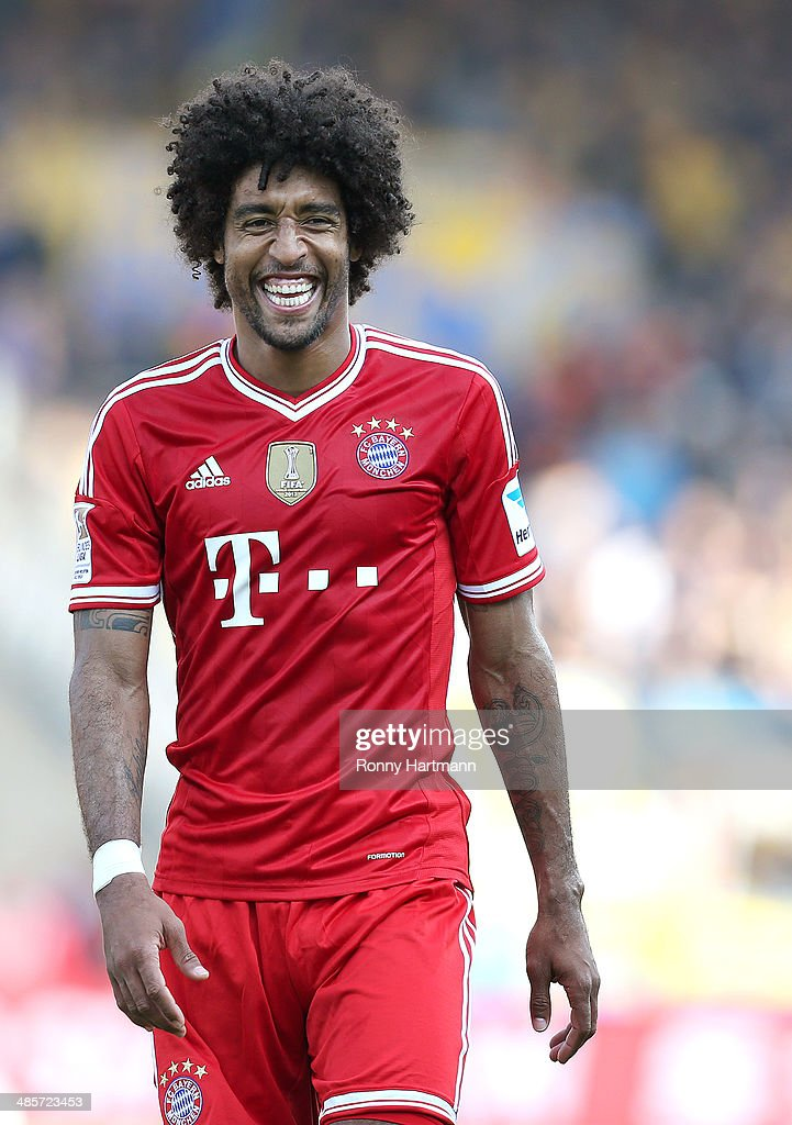 Dante of Muenchen smiles after the Bundesliga match between Eintracht Braunschweig and FC Bayern Muenchen at Eintracht Stadion on April 19, 2014 in Braunschweig, Germany.