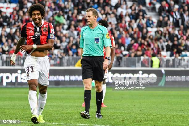 Dante of Nice and the referee Olivier Thual during the Ligue 1 match between OGC Nice and Dijon FCO at Allianz Riviera on November 5 2017 in Nice