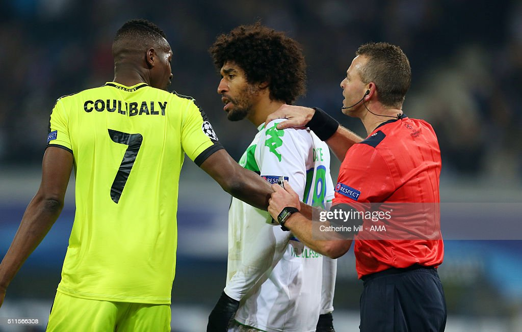 Dante of Wolfsburg and Kalifa Coulibaly of Gent are pulled apart by Referee <a gi-track='captionPersonalityLinkClicked' href=/galleries/search?phrase=Svein+Oddvar+Moen&family=editorial&specificpeople=6489051 ng-click='$event.stopPropagation()'>Svein Oddvar Moen</a> during the UEFA Champions League match between KAA Gent and VfL Wolfsburg at Ghelamco Arena, on February 17, 2016 in Gent, Belgium.