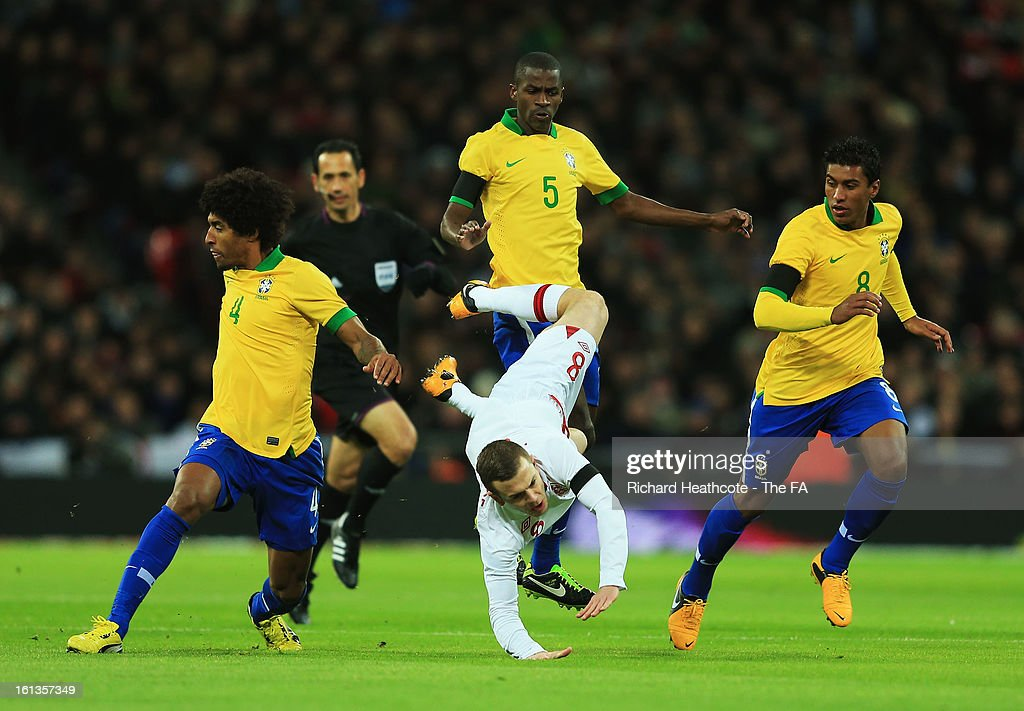Dante (L), Paulinho (R) and Ramires of Brazil challenge Jack Wilshere of England during the International Friendly match between England and Brazil at Wembley Stadium on February 6, 2013 in London, England.