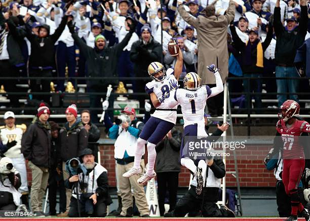 Dante Pettis of the Washington Huskies celebrates his touchdown with teammate John Ross in the first half against the Washington State Cougars during...