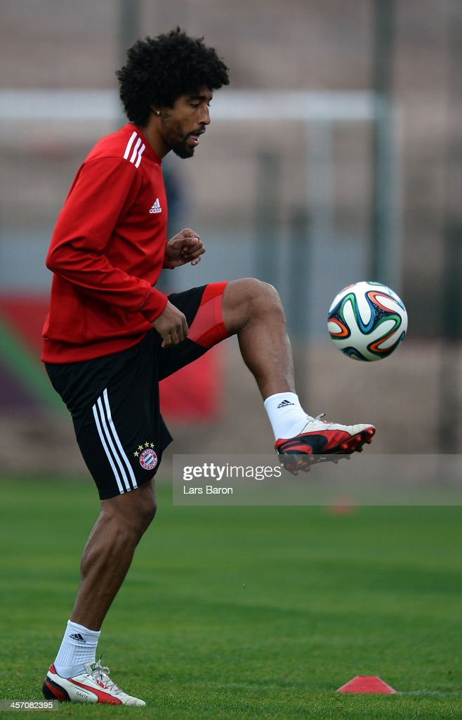 Dante plays with the ball during a Bayern Muenchen training session for the FIFA Club World Cup next to Agadir Stadium on December 16, 2013 in Agadir, Morocco.