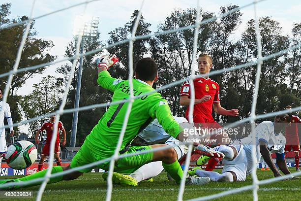 Dante Rigo of Belgium scores against Michael Perello of Honduras during the FIFA U17 World Cup Chile 2015 group D match between Belgium and Honduras...