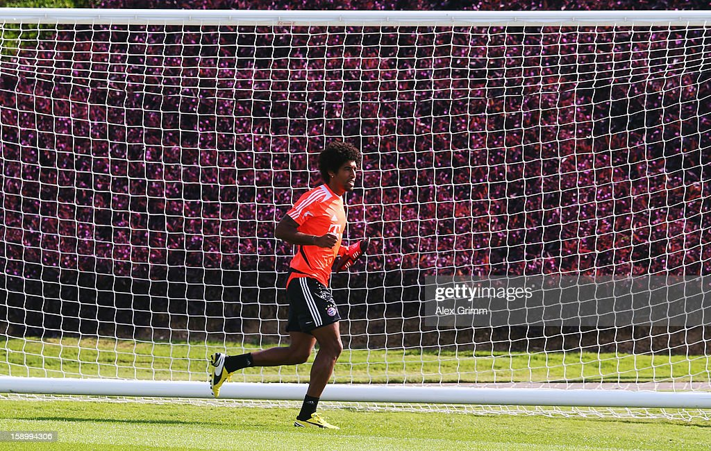 Dante runs during a Bayern Muenchen training session at the ASPIRE Academy for Sports Excellence on January 5, 2013 in Doha, Qatar.
