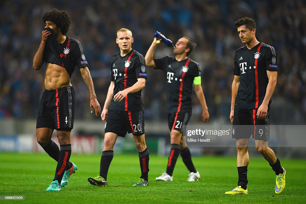 Dante Sebastian Rode Philipp Lahm and Robert Lewandowski of Bayern Muenchen look dejected in defeat after the during the UEFA Champions League...