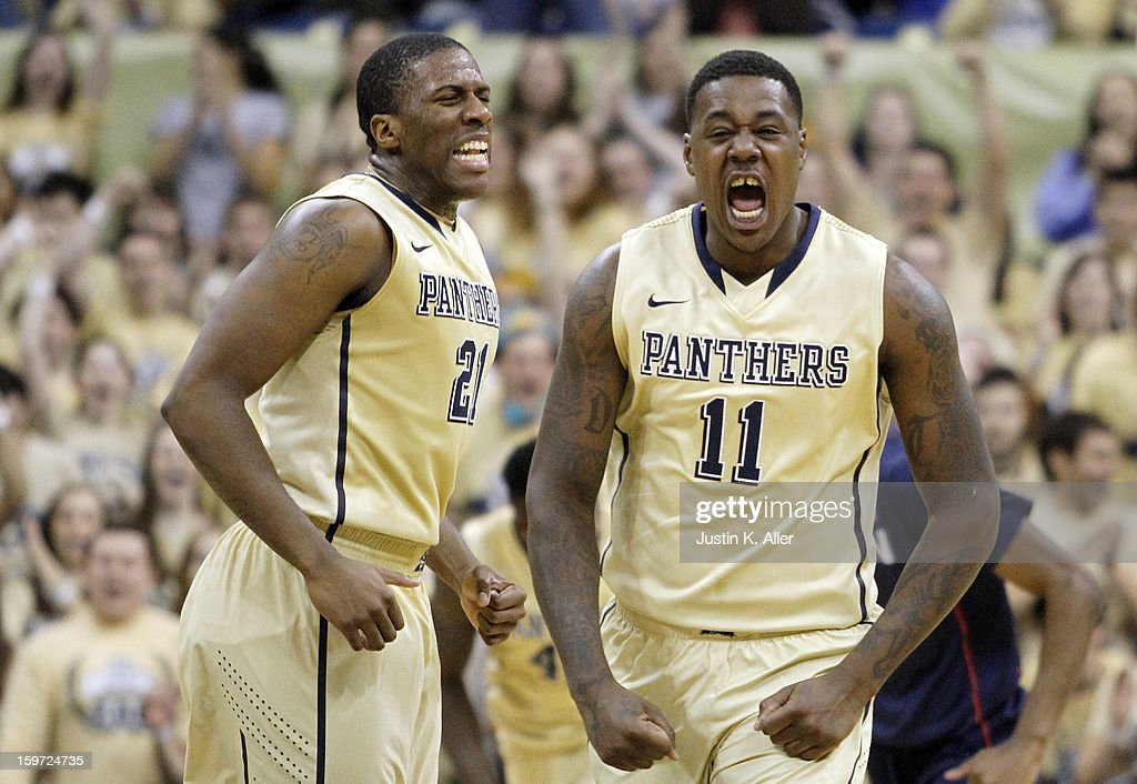 Dante Taylor #11 and Lamar Patterson #21 of the Pittsburgh Panthers celebrate after putting the game away late in the second half at Petersen Events Center on January 19, 2013 in Pittsburgh, Pennsylvania. PITT defeated UCONN