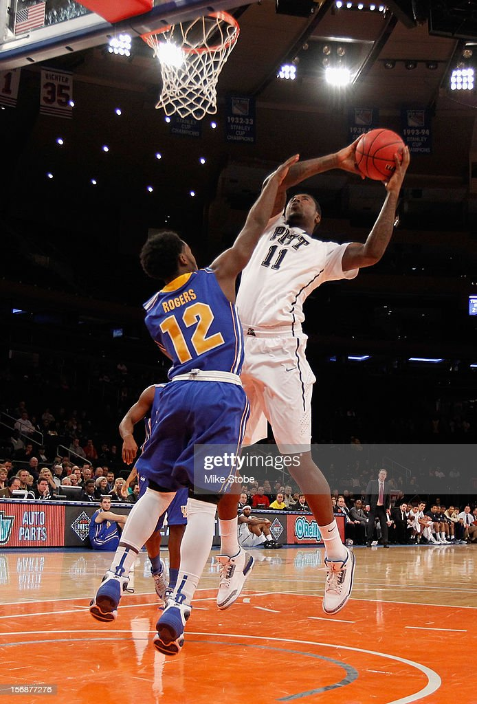 Dante Taylor #11 of the Pittsburgh Panthers drives to the net against Terrell Rogers #12 of the Delaware Fightin' Blue Hens at Madison Square Garden on November 23, 2012 in New York City. Pittsburgh Panthers defeated the Delaware Fightin' Blue Hens 85-59.